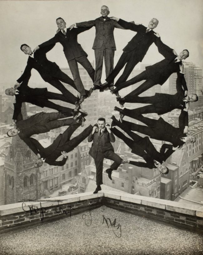 Unidentified American artist Man on Rooftop with Eleven Men in Formation on His Shoulders ca. 1930